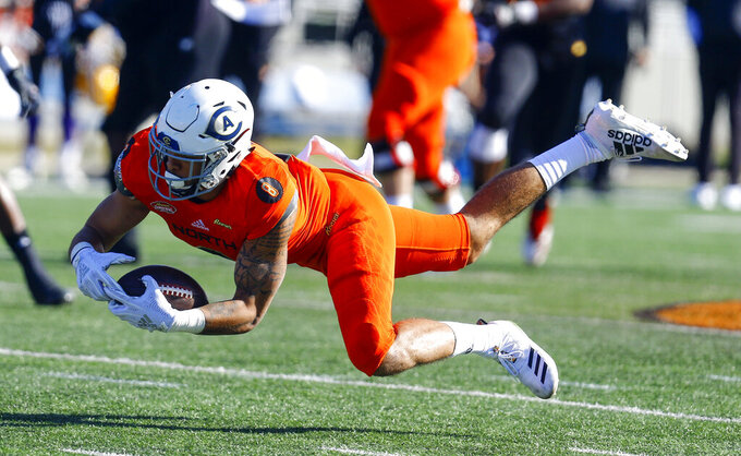 North wide receiver Keelan Doss, of UC Davis, makes a diving catch during the first half of the Senior Bowl college football game, Saturday, Jan. 26, 2019, in Mobile, Ala. (AP Photo/Butch Dill)