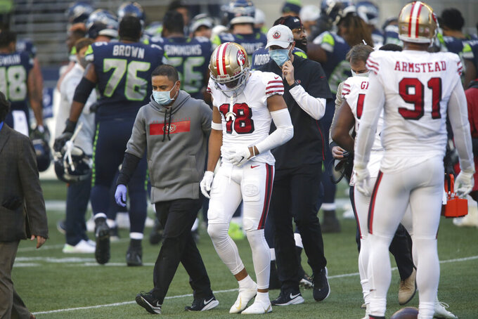 San Francisco 49ers wide receiver Dante Pettis (18) leaves the field with an injury during the second half of an NFL football game against the Seattle Seahawks, Sunday, Nov. 1, 2020, in Seattle. The Seahawks won 37-27. (AP Photo/Scott Eklund)