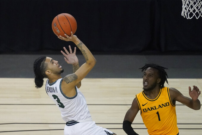 Cleveland State's Craig Beaudion (3) puts up a shot against Oakland's Rashad Williams (1) during the first half of an NCAA college basketball game in the men's Horizon League conference tournament championship game, Tuesday, March 9, 2021, in Indianapolis. (AP Photo/Darron Cummings)