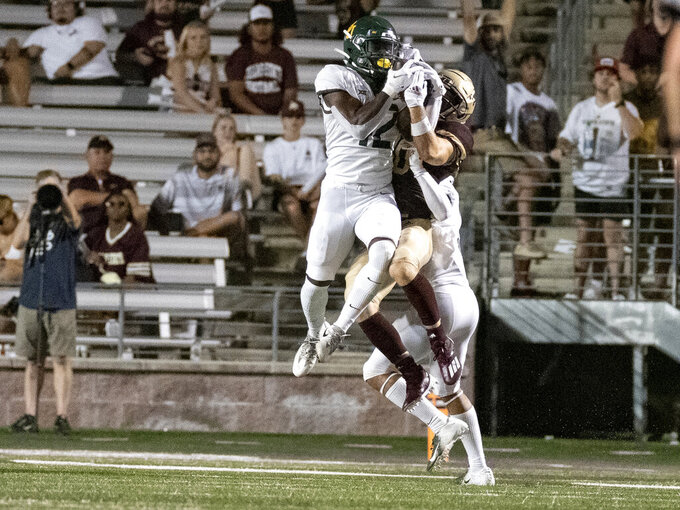 Baylor defenders Jairon McVea, left, intercepts a pass to Texas State receiver Chandler Speights, center, during the second half of an NCAA college football game, Saturday, Sept. 4, 2021, in San Marcos, Texas. Baylor won 29-20. (AP Photo/Michael Thomas)