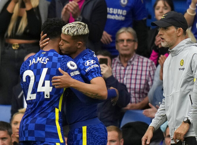 Chelsea's Reece James, left, leaves the field after sustaining an injury during the English Premier League soccer match between Chelsea and Manchester City at Stamford Bridge Stadium in London, Saturday, Sept. 25, 2021. (AP Photo/Alastair Grant)