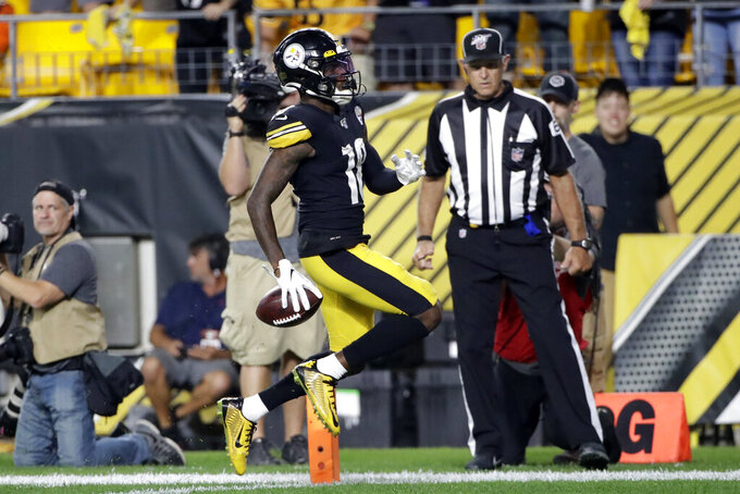 Pittsburgh Steelers wide receiver Diontae Johnson (18) crosses the goal line after taking a pass from quarterback Mason Rudolph during the second half of an NFL football game against the Cincinnati Bengals in Pittsburgh, Monday, Sept. 30, 2019. (AP Photo/Tom E. Puskar)