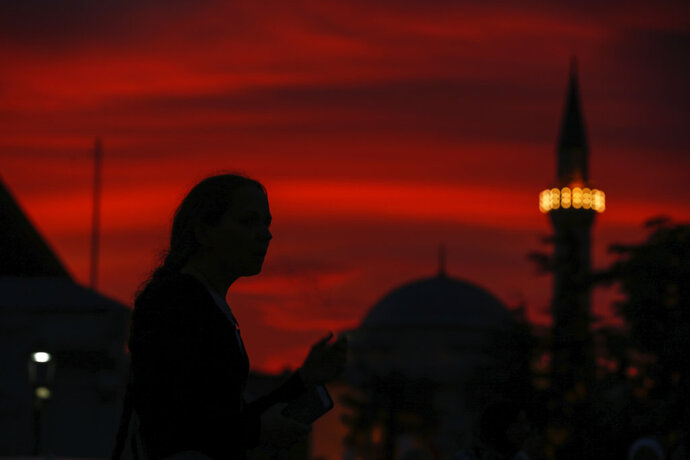 People walk in the historic Sultanahmet district of Istanbul, Wednesday, May 16, 2018 on the first day of the fasting month of Ramadan. Muslims throughout the world are marking Ramadan - a month of fasting during which the observants abstain from food, drink and other pleasures from sunrise to sunset. After an obligatory sunset prayer, a large feast known as 'iftar' is shared with family and friends. (AP Photo/Emrah Gurel)