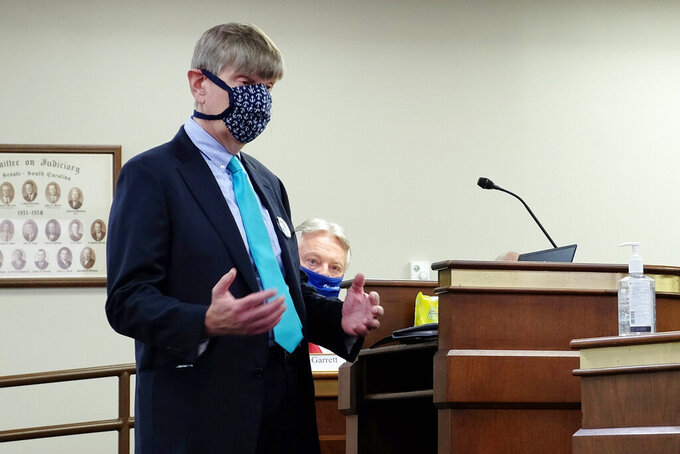Dr. Edward Simmer answers questions from the South Carolina Senate Medical Affairs committee in Columbia, S.C., on Tuesday, Feb. 2, 2021. Simmer was nominated to lead the South Carolina Department of Health and Environmental Control by the agency's board in December and must be confirmed by the state Senate before he can take charge. (AP Photo/Michelle Liu)