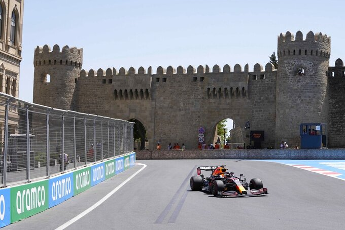 Red Bull driver Max Verstappen of the Netherlands steers his car during the first free practice at the Baku Formula One city circuit, in Baku, Azerbaijan, Friday, June 4, 2021. The Formula one race will be held on Sunday. (AP Photo/Darko Vojinovic)