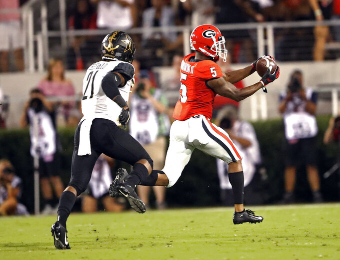 Georgia wide receiver Terry Godwin (5) catches a pass for a touchdown as Vanderbilt cornerback Donovan Sheffield (21) defends during the first half of an NCAA college football game Saturday, Oct. 6, 2018, in Atlanta. (AP Photo/John Bazemore)