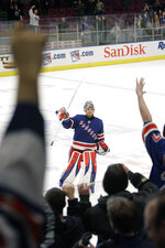 FILE  - In this Tuesday, Feb. 27, 2007, file photo, New York Rangers goalie Henrik Lundqvist celebrates with the fans after being named the most valuable star of the game at the end of the third period of the NHL hockey game against the Montreal Canadiens, at Madison Square Garden in New York. The Rangers defeated the Canadiens 4-0. The New York Rangers have bought out the contract of star goaltender Henrik Lundqvist. The Rangers parted with one of the greatest netminders in franchise history on Wednesday, Sept. 30, 2020, when they paid off the final year of his contract. (AP Photo/Mary Altaffer, File)
