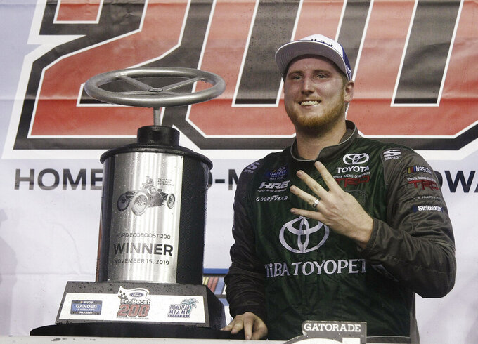 Austin Hill celebrates in Victory Lane after winning the NASCAR Truck Series auto race Friday, Nov. 15, 2019, at Homestead-Miami Speedway in Homestead, Fla. (AP Photo/Darryl Graham)