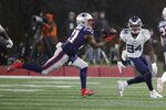 New England Patriots safety Duron Harmon, left, intercepts a pass in front of Tennessee Titans wide receiver Corey Davis in the second half of an NFL wild-card playoff football game, Saturday, Jan. 4, 2020, in Foxborough, Mass. (AP Photo/Elise Amendola)