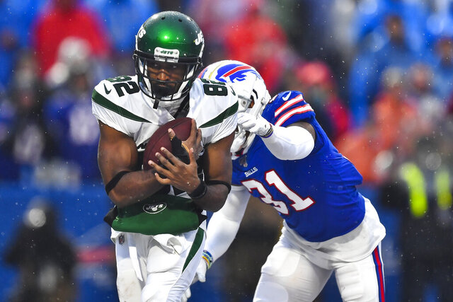 File-New York Jets wide receiver Jamison Crowder (82) catches a pass for a touchdown in front of Buffalo Bills' Dean Marlowe (31) during the second half of an NFL football game Sunday, Dec. 29, 2019, in Orchard Park, N.Y.  New York Jets wide receivers Breshad Perriman and Crowder sat out practice Wednesday, Sept. 23, 2020, with injuries, and they could miss the team's game at Indianapolis on Sunday. (AP Photo/Adrian Kraus, File)