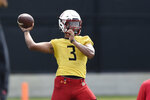 Maryland football quarterback Taulia Tagovailoa throws during a NCAA college football practice Friday, Aug.6, 2021, in College Park, Md.(AP Photo/Gail Burton)