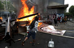 Items removed from a church by anti-government protesters go up in flames in a barricade built by the protesters, in Santiago, Chile, Friday, Nov. 8, 2019.  Chile's president on Thursday announced measures to increase security and toughen sanctions for vandalism following three weeks of protests that have left at least 20 dead. (AP Photo/Esteban Felix)