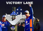 Brad Keselowski, right, celebrates in Victory Lane after winning a Monster Energy NASCAR Cup Series auto race at Atlanta Motor Speedway, Sunday, Feb. 24, 2019, in Hampton, Ga. (AP Photo/Scott Cunningham)