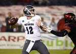 Nevada quarterback Carson Strong (12) delivers a pass during the first half of the team's NCAA college football game against San Diego State on Saturday, Nov. 9, 2019, in San Diego. (AP Photo/Denis Poroy)