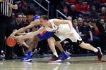 San Diego State guard Malachi Flynn, right, steals the ball from Boise State guard RayJ Dennis during the first half of an NCAA college basketball game Saturday, Jan. 11, 2020, in San Diego. (AP Photo/Gregory Bull)