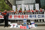 In this July 15, 2019, photo, South Korean small and medium-sized business owners stage a rally calling for a boycott of Japanese products in front of the Japanese embassy in Seoul, South Korea. Seoul has accused Tokyo of weaponizing trade to retaliate against South Korean court rulings calling for Japanese companies to offer reparations to South Koreans forced into slave labor during World War II. Sales of Japanese beer, clothes and other goods have declined sharply as have travels to Japan amid boycott campaigns. The signs read: