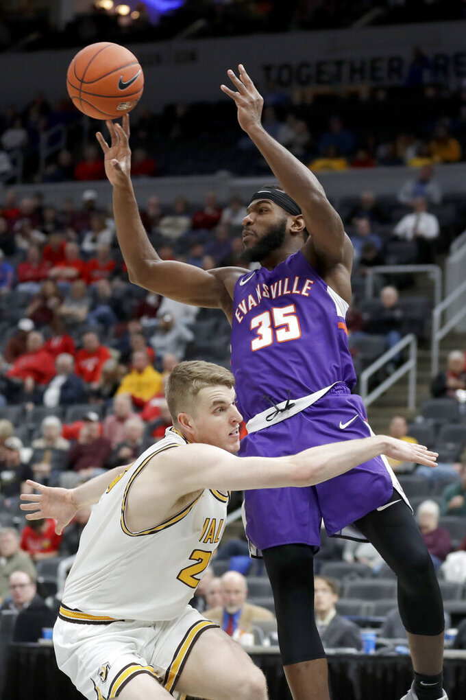 Evansville's John Hall (35) passes over Valparaiso's Ben Krikke during the first half of an NCAA college basketball game in the first round of the Missouri Valley Conference men's tournament Thursday, March 5, 2020, in St. Louis. (AP Photo/Jeff Roberson)