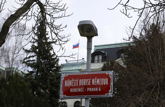 A newly unveiled sign renaming the square where the Russian embassy is located in Prague, Czech Republic, Thursday Feb. 27, 2020, named after the late Russian opposition leader Boris Nemtsov. Nemtsov was gunned down outside the Kremlin 5 years ago. (AP Photo/Petr David Josek)
