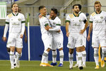 Portland Timbers' Andres Flores (14) is congratulated after scoring against the Seattle Sounders in the first half of an MLS soccer match Thursday, Oct. 22, 2020, in Seattle. (AP Photo/Elaine Thompson)