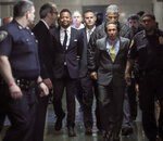 Cuba Gooding Jr., third from left, is escorted handcuffed as he arrives in court to face sexual misconduct charges, Tuesday Oct. 15, 2019, in New York. Gooding Jr. pleaded not guilty to an indictment alleging two instances of sexual misconduct. The new charge involves an alleged incident in October 2018. The defense paints it as a shakedown attempt. (AP Photo/Bebeto Matthews)