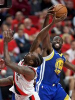 Golden State Warriors forward Draymond Green, right, blocks the shot of Portland Trail Blazers forward Al-Farouq Aminu during the second half of Game 4 of the NBA basketball playoffs Western Conference finals Monday, May 20, 2019, in Portland, Ore. The Warriors won 119-117 in overtime. (AP Photo/Craig Mitchelldyer)