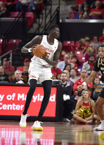 Maryland freshman center Chol Marial (15) works the floor during the first half of an NCAA college basketball game against Bryant University, Sunday, Dec. 29, 2019, in College Park, Md. (AP Photo/Brien Aho)