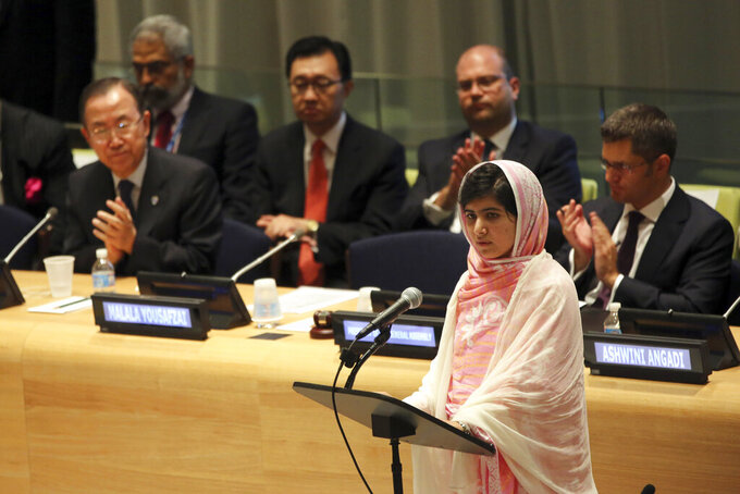 FILE- In this file photo dated Friday, July 12, 2013, United Nations Secretary-General Ban Ki-moon, left, applauds as Malala Yousafzai addresses the 'Malala Day' Youth Assembly, at United Nations headquarters. In his General Assembly opening address on Tuesday, Sept. 21, 2021, U.N. Secretary-General Antonio Guterres practically scolded world leaders for disappointing young people with a perceived inaction on climate change, inequalities and the lack of educational opportunities, among other issues important to young people. (AP Photo/Mary Altaffer, FILE)