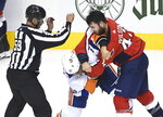 Washington Capitals right wing Tom Wilson (43) fights New York Islanders left wing Anders Lee (27) during the first period of an NHL Eastern Conference Stanley Cup hockey playoff game in Toronto, Wednesday, Aug. 12, 2020. (Nathan Denette/The Canadian Press via AP)