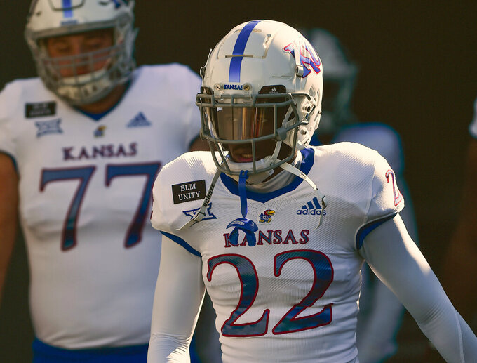 Kansas Jayhawks cornerback Duece Mayberry makes his way onto field  before an NCAA college football game against West Virginia, Saturday, Oct. 17, 2020, in Morgantown W.Va. (William Wotring/The Dominion-Post via AP)