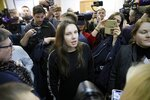 Alla Ilyina, who broke out of the hospital on Feb. 7 after learning that she would have to spend 14 days in isolation instead of the 24 hours doctors promised her, speaks to the Media in a courtroom in St.Petersburg, Russia, Monday, Feb. 17, 2020. A woman who escaped from a hospital in St. Petersburg, where she was being kept in isolation for possible inflection by the new coronavirus, was ordered by court on Monday to return back to the quarantine for at least two days. (AP Photo/Dmitri Lovetsky)