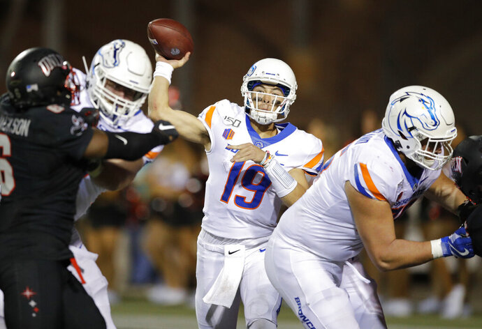 Boise State quarterback Hank Bachmeier throws a pass against UNLV during the second half of an NCAA college football game Saturday, Oct. 5, 2019, in Las Vegas. (AP Photo/John Locher)