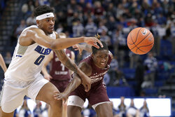 Southern Illinois' Harwin Francois, right, and Saint Louis' Jordan Goodwin reach for the ball as it goes out of bounds during the first half of an NCAA college basketball game Sunday, Dec. 1, 2019, in St. Louis. (AP Photo/Jeff Roberson)