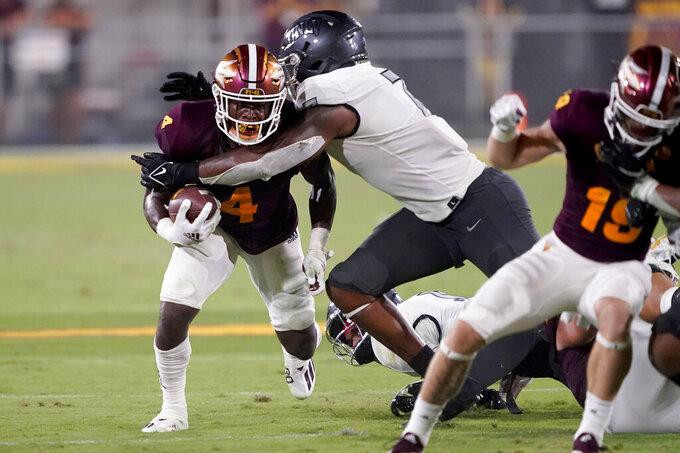 UNLV defensive lineman Adam Plant Jr. tackles Arizona State running back Daniyel Ngata (4) during the second half of an NCAA college football game, Saturday, Sept. 11, 2021, in Tempe, Ariz. (AP Photo/Matt York)