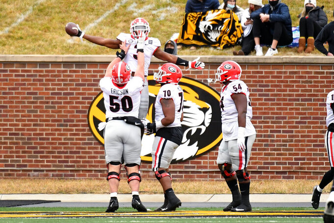 Georgia running back Zamir White (3) is congratulated by teammates after scoring during the second half of an NCAA college football game against Missouri Saturday, Dec. 12, 2020, in Columbia, Mo. (AP Photo/L.G. Patterson)