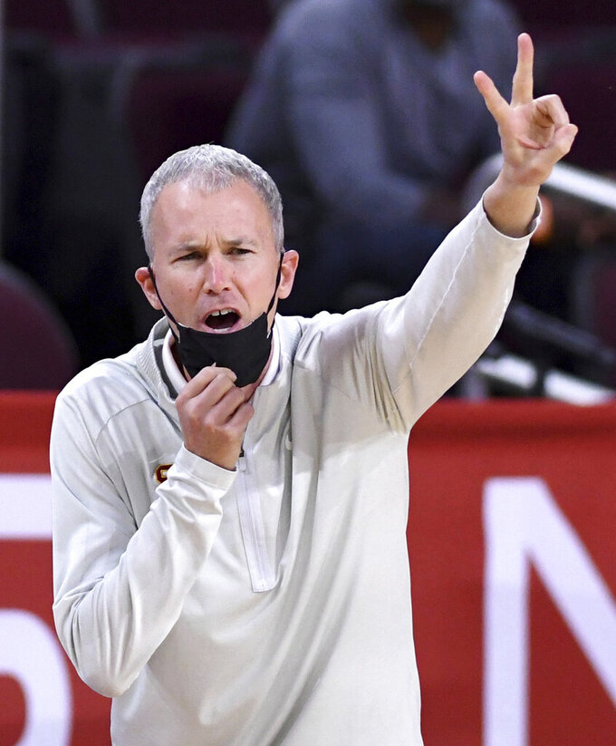 Southern California coach Andy Enfield signals to the team during the first half of an NCAA college basketball game against Washington State in Los Angeles on Saturday, Jan. 16, 2021. (Keith Birmingham/The Orange County Register via AP)