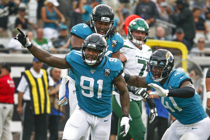 Jacksonville Jaguars defensive end Yannick Ngakoue (91) celebrates after sacking New York Jets quarterback Sam Darnold during the first half of an NFL football game, Sunday, Oct. 27, 2019, in Jacksonville, Fla. (AP Photo/Stephen B. Morton)