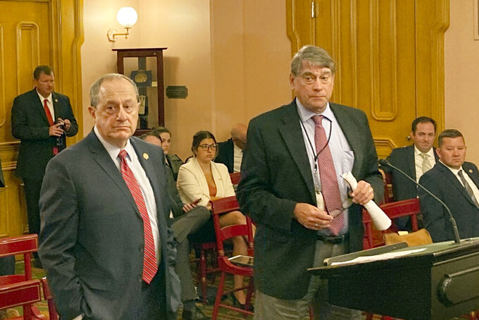 State Rep. David Leland, left, a Columbus Democrat, and Rep. Bill Seitz, a Cincinnati Republican, conclude their testimony on bipartisan legislation that would once again allow Ohio utility companies to offer energy efficient programs like smart thermostats and appliance rebates, on Wednesday, Sept. 22, 2021, in Columbus, Ohio. Previous legislation meant to shore up aging power plants eliminated such programs, but that bill has been largely discredited after federal prosecutors alleged a $60 million bribery scheme helped enact the legislation. (AP Photo/Andrew Welsh-Huggins)