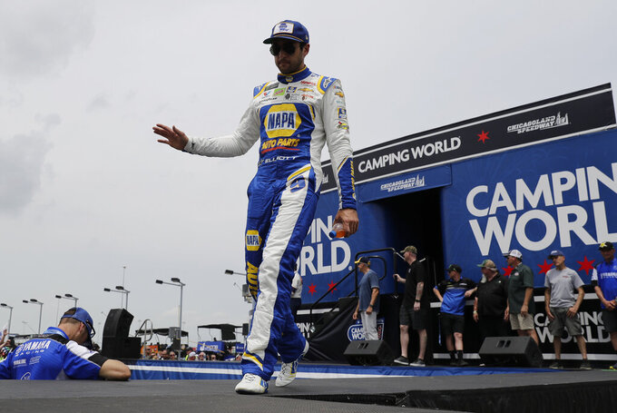 Chase Elliott waves to the crowd during drivers introduction before the NASCAR Cup Series auto race at Chicagoland Speedway in Joliet, Ill., Sunday, June 30, 2019. (AP Photo/Nam Y. Huh)