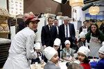 French President Emmanuel Macron poses with bakers during a visit to the International Agriculture Fair (Salon de l'Agriculture) at the Porte de Versailles exhibition center in Paris, Saturday, Feb. 22, 2020. (Benoit Tessier/Pool via AP)