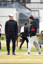 San Francisco 49ers general manager John Lynch, left, and head coach Kyle Shanahan, right, watches as players practice at the team's NFL football practice facility in Santa Clara, Calif., Wednesday, Jan. 15, 2020. The 49ers will host the Green Bay Packers for the NFC Championship on Sunday. (AP Photo/Tony Avelar)