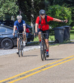 Phil Baker, right, a lifelong athlete who turns 80 on Aug. 28, begins his bicycle ride with his co-rider Britt Drummond, left, Tuesday Aug. 24, 2021, in Baton Rouge, La. Baker is celebrating his 80th birthday by cycling 80 miles a day for 10 days straight.(Bill Feig/The Advocate via AP)