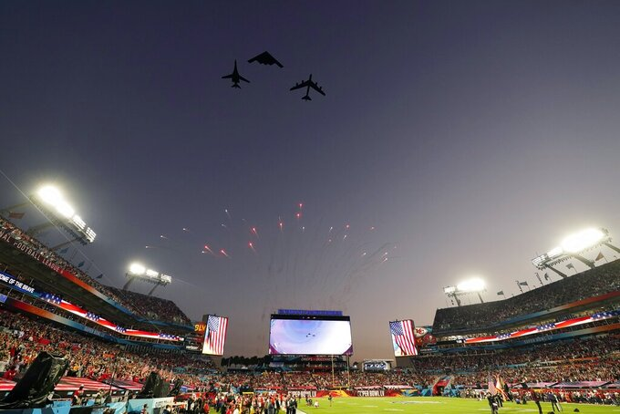 Planes fly over the stadium before the NFL Super Bowl 55 football game between the Kansas City Chiefs and Tampa Bay Buccaneers, Sunday, Feb. 7, 2021, in Tampa, Fla. (AP Photo/Mark Humphrey)