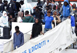 Migrants disembark from Italian Coast Guard vessell