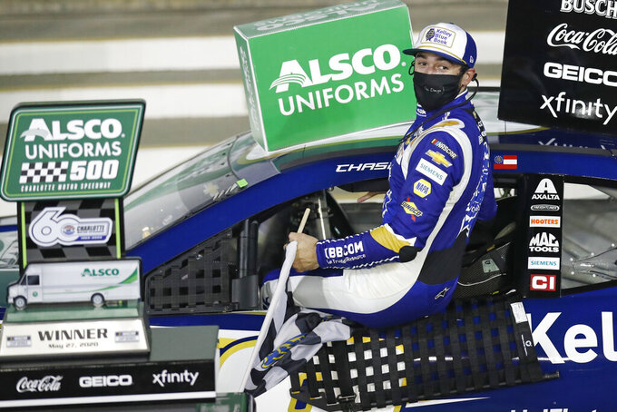 Chase Elliott gets out of his car after winning a NASCAR Cup Series auto race at Charlotte Motor Speedway Thursday, May 28, 2020, in Concord, N.C. (AP Photo/Gerry Broome)