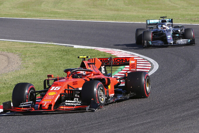 Ferrari driver Charles Leclerc of Monaco leads Mercedes driver Lewis Hamilton of Britain during the Japanese Formula One Grand Prix at Suzuka Circuit in Suzuka, central Japan, Sunday, Oct. 13, 2019. (AP Photo/Toru Takahashi)