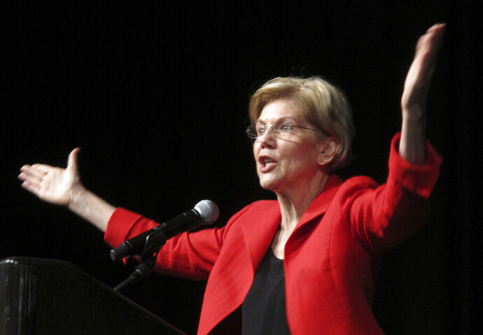 In this June 23, 2018 photo, Sen. Elizabeth Warren, D-Mass., delivers the keynote address to the Nevada Democratic Convention in Reno, Nev. Warren's plan to pay for Medicare for All without raising middle-class taxes departs from the shared responsibility the U.S. has traditionally required for bedrock programs. (AP Photo/Scott Sonner)