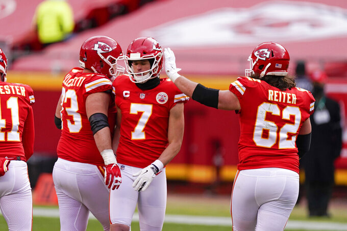 Kansas City Chiefs place kicker Harrison Butker (7) celebrates with teammates after kicking a 50-yard field goal during the first half of an NFL divisional round football game against the Cleveland Browns, Sunday, Jan. 17, 2021, in Kansas City. (AP Photo/Charlie Riedel)