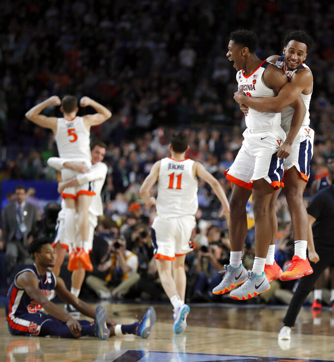 Virginia players celebrate after defeating Auburn 63-62 in the semifinals of the Final Four NCAA college basketball tournament, Saturday, April 6, 2019, in Minneapolis. (AP Photo/Charlie Neibergall)