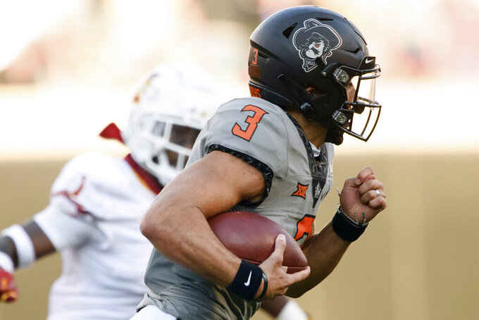 Oklahoma State quarterback Spencer Sanders (3) runs the ball during an NCAA college football game against Iowa State, Saturday, Oct. 24, 2020, in Stillwater, Okla. (AP Photo/Brody Schmidt)