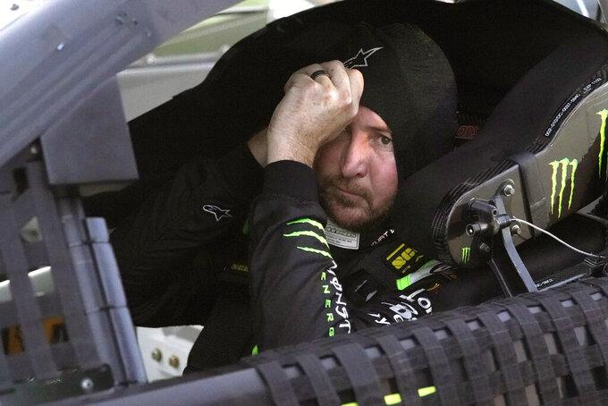 Kurt Busch prepares himself before the start of the NASCAR Cup Series auto race at Daytona International Speedway, Saturday, Aug. 28, 2021, in Daytona Beach, Fla. (AP Photo/John Raoux)